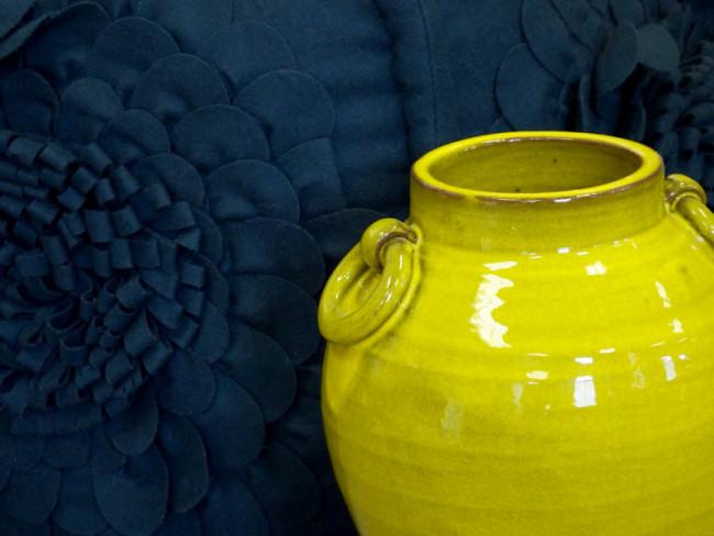 Green urn with deep blue felt pillow
